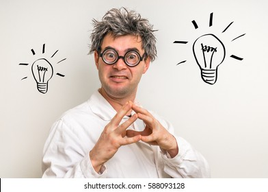 Crazy scientist got the great idea in laboratory with bulb symbol