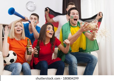 Crazy soccer fans during the football match