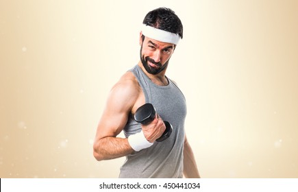 Crazy sportman over ocher background