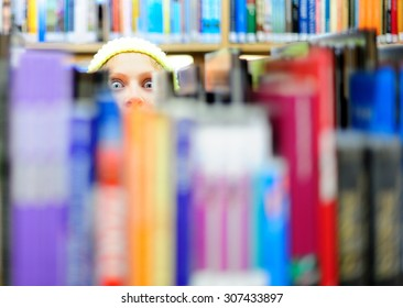 Crazy stare behind the books