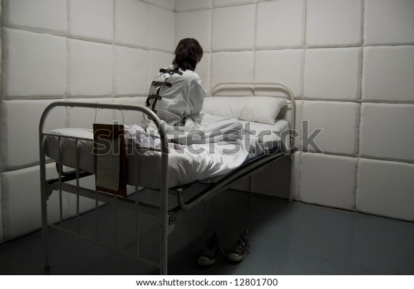 Crazy with a straitjacket in a Psychiatric