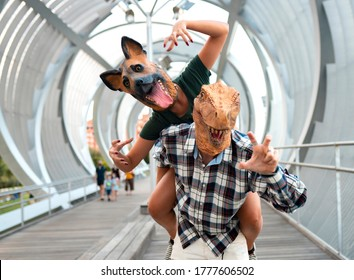 Crazy and stylish people- Fashion couple wearing t-rex and dog mask, Absurd, vacation and funny trend concept -