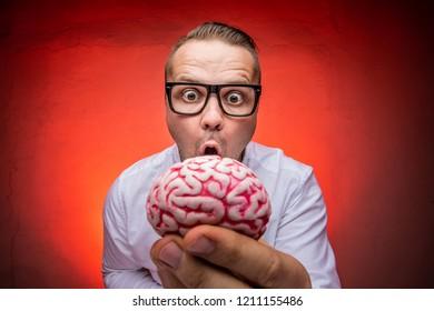 Crazy teacher or scientist with brain