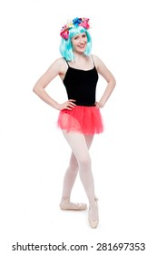 Crazy wig flowers girl tutu leotard ballet pose in studio on white background.