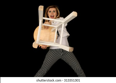 Crazy woman holding a bar stool out