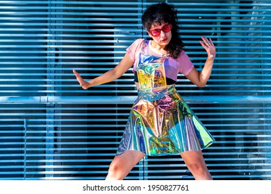Crazy woman wearing surrealistic outfit posing at grey iron gratings.