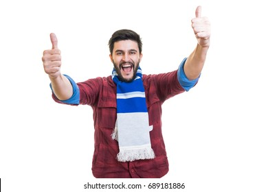 Crazy young bearded sports fan with white-blue color scarf tied on his neck showing his delight by victory