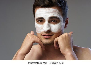Cream against black dots rejuvenation spa treatments young man clean skin cosmetology
