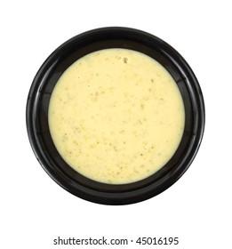 Cream of broccoli soup in black bowl