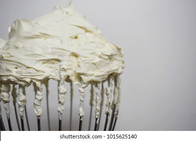 Cream butter on the head of the mixer large.