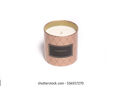 Cream candle in gift metal brown box with a tag isolated on white background
