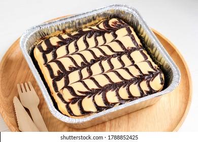 Cream Cheese Brownies on Alumunium Foil Baking Dish with Beautiful Swirl Motive on Top