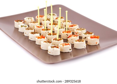 Cream cheese on brown plate on white background.