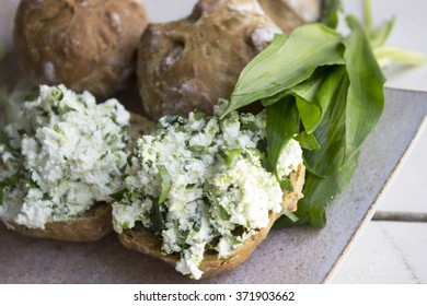 cream cheese on organic bread with wild garlic leaves