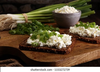 Cream Cheese on a slice of bread topped with fresh green onions or spring onions