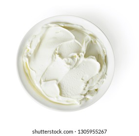 Cream cheese, quark or yogurt in a white bowl. Dairy product, healthy eating theme. Isolated object on white background.