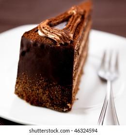 Cream, chocolate cake with cocoa