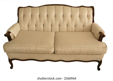 Cream colored vintage couch isolated