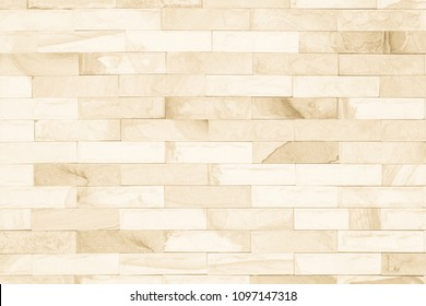 Cream colors and white brick wall art concrete stone texture background in wallpaper limestone abstract paint to flooring and homework/Brickwork or stonework clean grid uneven interior rock old.