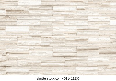 Cream colors and white brick wall art concrete or stone texture background in  wallpaper limestone abstract paint to flooring and homework/Brickwork or stonework clean grid uneven interior rock old.
