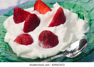 cream dessert with strawberries on table