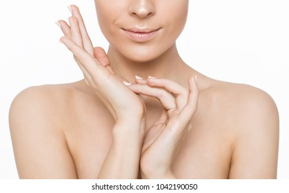 The cream for the face and hands. Close up portrait of beautiful young woman with clean fresh skin. Make up. Cosmetics and cosmetology. Care of skin. Spa treatments. Women Health.
