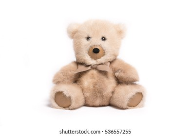 Cream fluffy teddy bear toy isolated on white background