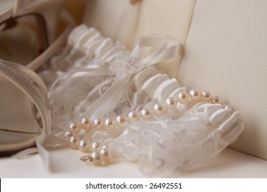 Cream garter and pearls