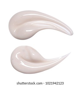 Cream isolated on white. A sample of cosmetics. Smear cream for face