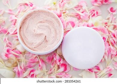cream jar with flower petal