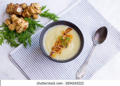 Cream of Jerusalem artichoke soup. Vegetarian dish of Jerusalem artichoke tubers.