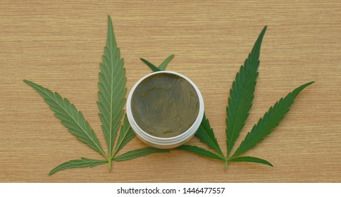 Cream medicinal cannabis hemp and leaf cannabidiol CBD harvested dried of seeds quality for production of ointments, relieves pain, antibacterial and soothing, seeds big bud with pistils and stigmas