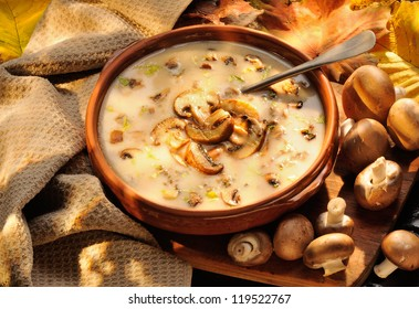Cream of mushroom soup. Home-made, country style with whole and sliced mushrooms.