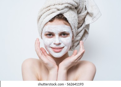 cream on her face, mask on the face, a towel on his head, problem skin