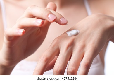 Cream on the women hand.