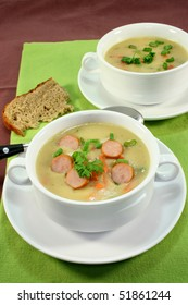 Cream of potato soup with vegetables and Vienna sausages