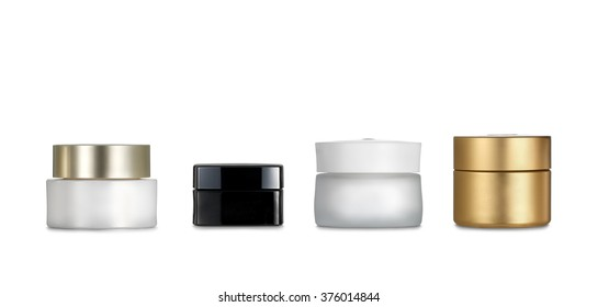 Cream pots. Four cosmetics containers isolated on white background. Clipping path