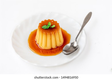 Cream pudding with caramel sauce   isolated on a white background. French Flan dessert