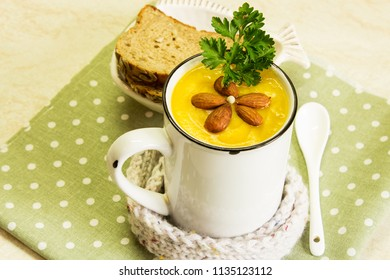 Cream of pumpkin soup with parsley and almonds. A traditional autumn dish.