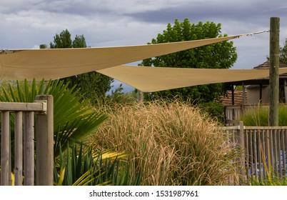 Cream sail shade strung out between posts