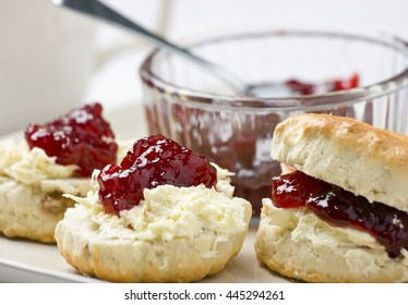 Cream scones with strawberry jam and clotted cream. Shallow depth of field.