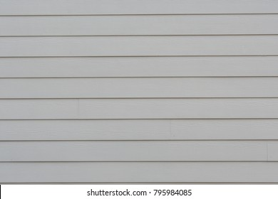 Cream Siding of House wide background image