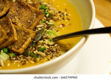 Cream soup with croutons and dill on white napkin, horizontal close up - Shutterstock ID 1665749965