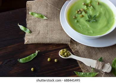 Cream soup with peas with vegetables on the table