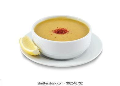 cream soup of yellow lentils, isolated on white