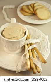 Cream spreads. Soft spreadable cream, bread sticks and pretzels. Creamy snack. Cream cheese and almonds. Pretzels. Bread sticks. Almond dip.