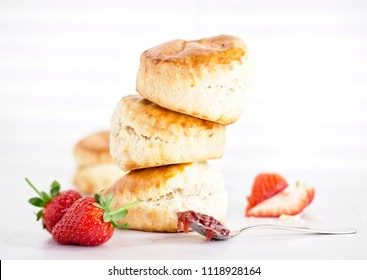 Cream Tea - scones with jam, cream and strawberrys on a white background