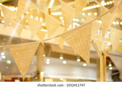 Cream triangular flags of decorated celebrate outdoor party. Vintage bunting flag. Can be use for wedding party, anniversary or any event.