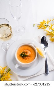 Cream of Vegetables Soup with Salmon and shrimp on a white background