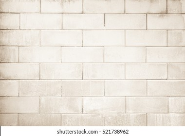 Cream and white block wall texture background / abstract wallpaper interior rock stone old pattern clean concrete grid uneven bricks design stack.